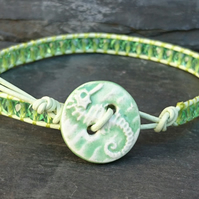 Pale green leather and glass bead bracelet with ceramic seahorse button