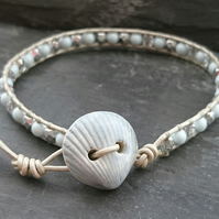 Ceramic shell button, leather and glass bead bracelet, silver and pale blue