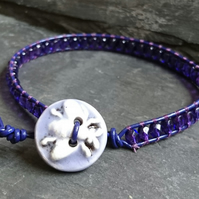 Purple leather and glass bead bracelet with ceramic bee button