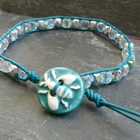 Teal leather and AB coated faceted glass bead bracelet with ceramic bee button
