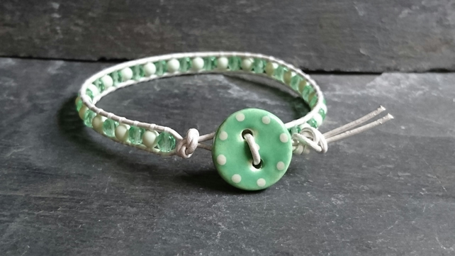 Green glass bead and pearl bracelet, ceramic polka dot button and silver leather
