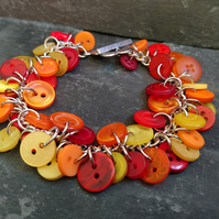 Red, orange and yellow charm style button bracelet