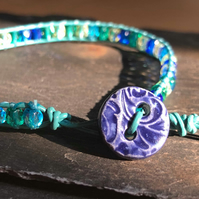 Blue and green mix glass bead and leather bracelet with ceramic button