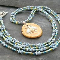 Ceramic bee pendant and seed bead necklace, mustard and blue