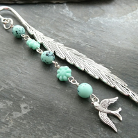 Feather bookmark with bird charm and green glass egg and flower beads