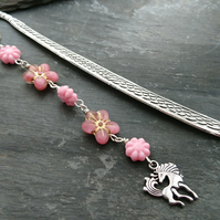Silver coloured bookmark with unicorn charm and pink flowery beads