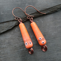 Orange drop earrings with copper swirl and handmade ear wires, lamp work beads