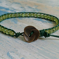 Peridot and leather bracelet with flower button, August semi-precious birthstone