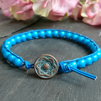 Turquoise glass pearl and blue leather bracelet with copper button