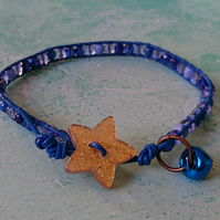 Blue leather bracelet with glass beads, festive gold glittery button and bell