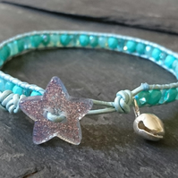 Festive aqua and mint leather and glass bracelet, glittery star button and bell