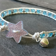 Festive blue and silver leather and bead bracelet with star button and bell