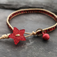 Rich red and gold festive bracelet with glittery star button and jingly bell