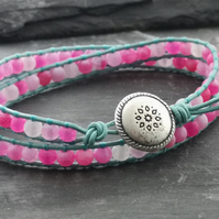 Pink agate and light teal leather bracelet with silver button with flower motif