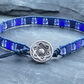 Blue leather and glass bead bracelet with decorative silver button