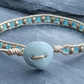 Gold leather and turquoise bead bracelet with ceramic shell button