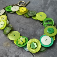 Green button necklace with antique gold chain