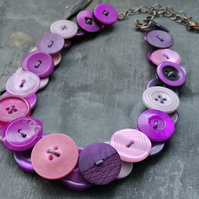 Button necklace in pinks and purples with copper chain