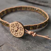 Leather bracelet with khaki glass beads and wooden button
