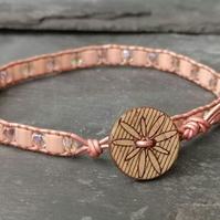 Rose gold leather bracelet with peach glass beads and wooden beads