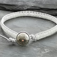 White leather and glass bead bracelet with star button
