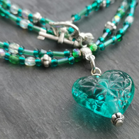 Teal lamp work heart necklace with seed beads and Swarovski crystals