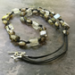 Grey, black and silver glass bead and cotton cord knotted necklace