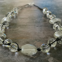 Chunky clear glass bead and knotted cotton cord necklace