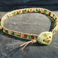 Tan leather bracelet with green ceramic shell button and Czech glass beads