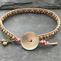 Metallic rose gold leather and glass bead bracelet with gold coloured button