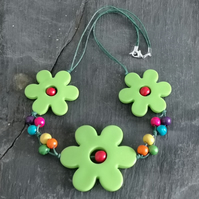 Green flower power acrylic necklace with rainbow wooden beads