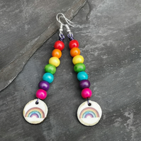 Long rainbow earrings with wooden beads and ceramic charm, Pride