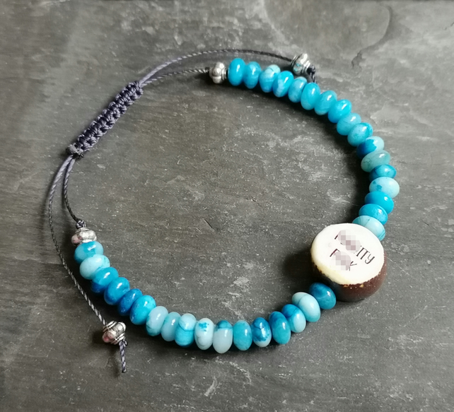 Turquoise bracelet with sweary ceramic bead, adjustable