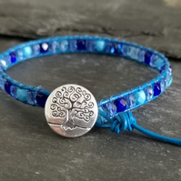 Leather bracelet with mixed blue faceted glass beads and decorative button