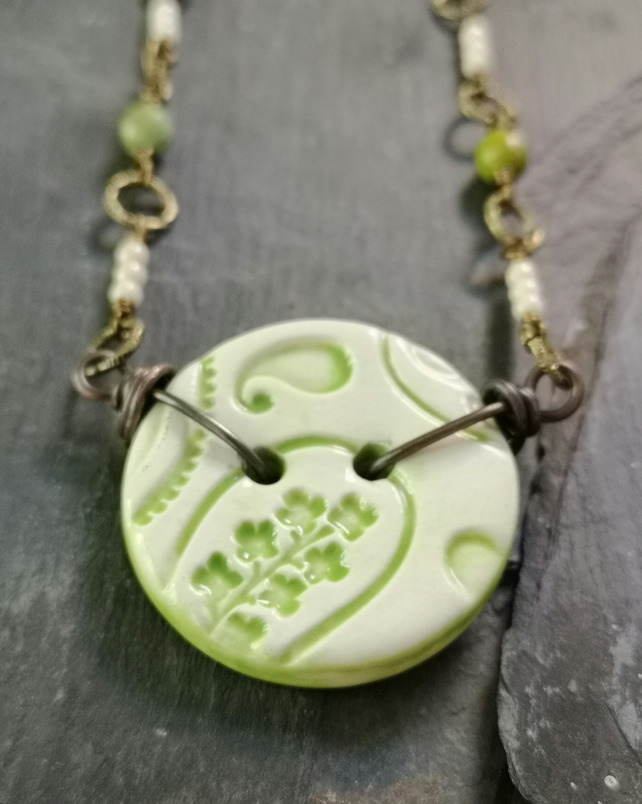 Green and cream ceramic button necklace with glass beads and antique gold chain