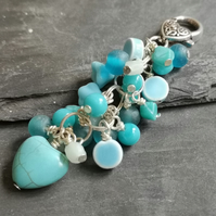 Silver bag charm with turquoise and blue glass beads