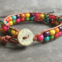 Leather bracelet with rainbow wooden beads and button fastener, Pride