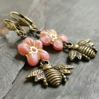 Pink flower and antique gold bee charm earrings, lever back ear wires