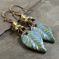 Ceramic leaf charm earrings with copper ear wires and glass beads