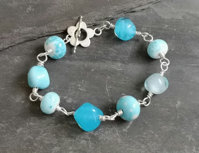 Pale blue and aqua lamp work bead bracelet with toggle clasp