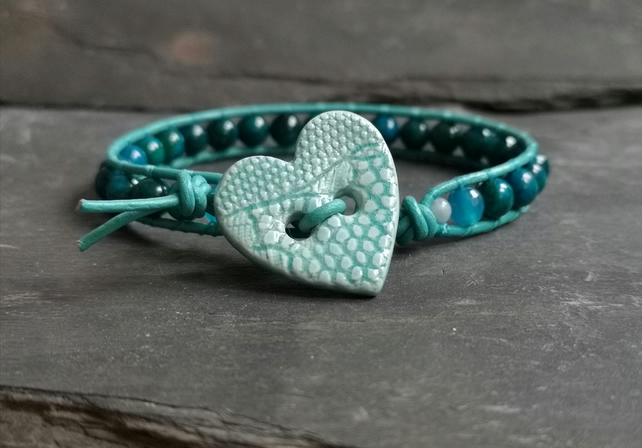 Teal leather and chrysocolla bead bracelet with ceramic heart button fastener