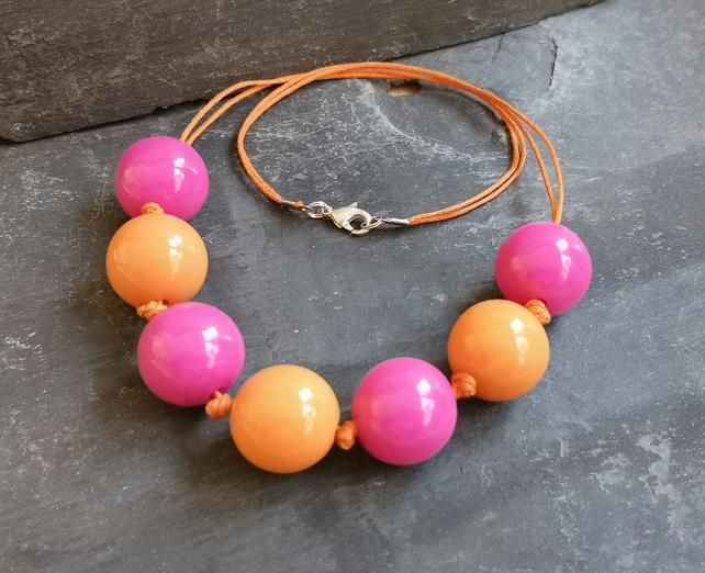 Pink and orange chunky acrylic necklace with orange cotton cord, lobster clasp
