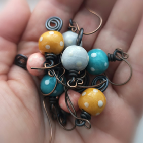 Polka dot ceramic bead earrings with copper wire