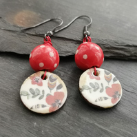 Ceramic red polka dot and floral charm earrings with gunmetal ear wires