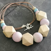 Necklace with pink and blue striped acrylic beads and natural wooden beads