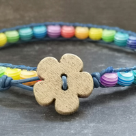 Blue leather bracelet, rainbow striped acrylic beads and wooden flower button