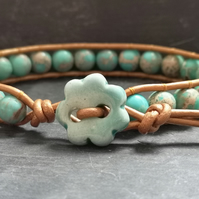 Turquoise jasper and bronze leather bracelet with ceramic flower button fastener