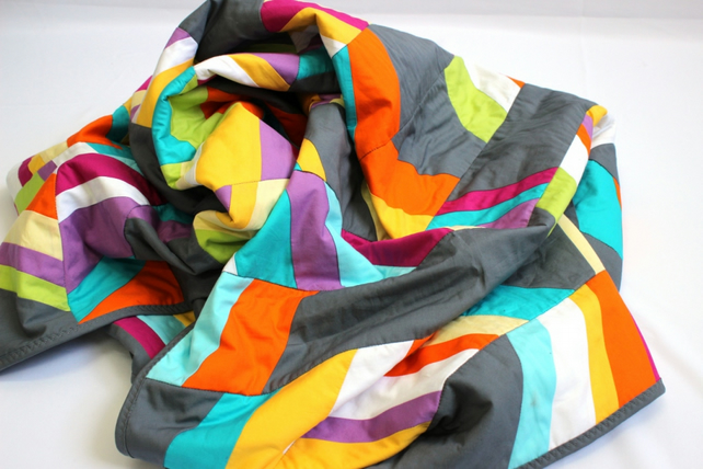 Modern patchwork quilt in bright and grey,