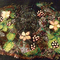 Blackberries and spider web textile art machine and hand embriodery