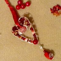 Silver plated wire heart with beads